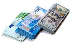 Пакеты денег в 3 валютах Стоковое Изображение