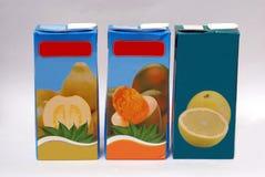 Пакеты тропических пить фруктового сока стоковое фото rf