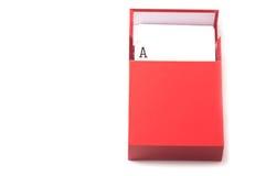 Пакет карточки внутри красной коробки Стоковые Изображения RF