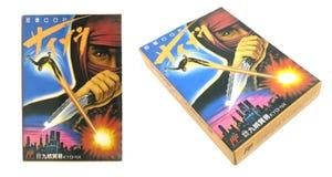 Пакет полисмена Ninja изолированный на белой предпосылке Стоковая Фотография