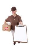 пакет работника доставляющего покупки на дом стоковое фото
