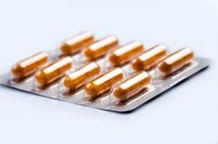 Пакет таблеток изолированных на белой предпосылке Стоковое Изображение