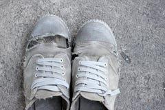 Пакостные старые ботинки, стиль натюрморта Стоковое Фото