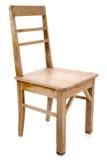 Пакостный старый деревянный стул изолированный на белизне стоковое фото rf