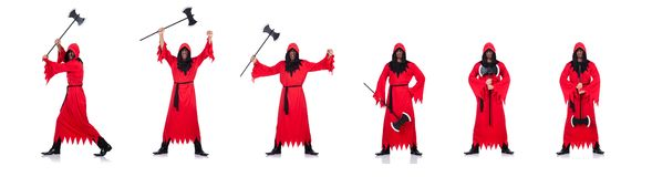 Палач в красном костюме с осью на белизне стоковое изображение