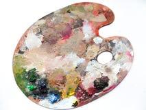 Палитра художников с цветами смешивает над белой предпосылкой Стоковая Фотография