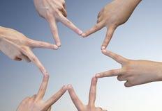 12 пальцев формируя звезду Стоковая Фотография RF