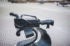 Памятник киносъемочного аппарата стоковые изображения