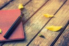 Память ручки и тетради в лете Стоковые Изображения RF