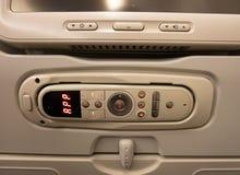 Панель с устройством для того чтобы контролировать мультимедийную систему самолета стоковые изображения