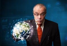 Панель земли 3d бизнесмена касающая высокотехнологичная Стоковые Фото