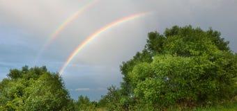Панорама ландшафта с радугой Стоковые Фотографии RF