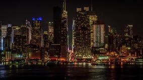 Панорама промежутка времени неимоверного света города nighttime большого устоичивая городского пейзажа здания Нью-Йорка Манхаттан сток-видео