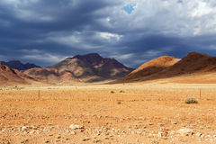 Панорама fantrastic ландшафта moonscape Намибии Стоковая Фотография RF