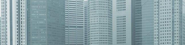 Панорамная предпосылка - окна зданий города высотного здания Стоковое Изображение RF