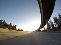 Пандус скоростного шоссе захода солнца Стоковые Фото