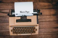 Папа Merci написанная на бумаге стоковые фото