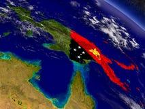 Папуаая-Нов Гвинея с врезанным флагом на земле Стоковое фото RF