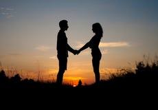 пара вручает удерживание Стоковые Изображения