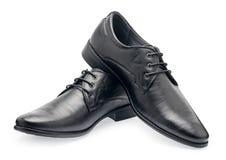 Пара классических черных кожаных ботинок для людей, с шнурками Стоковое фото RF