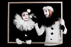 2 клоуна в рамке, одном смотрят скорбными Стоковая Фотография