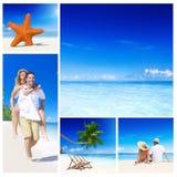 Пара ослабляя на пляже Стоковое Фото