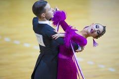 Пара танца Savastian Zolotov и Irina Komar выполняет программу стандарта Junior-2 Стоковая Фотография RF
