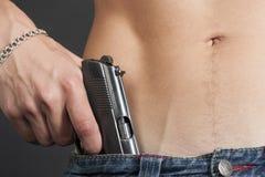 Парень джинсов пояса пистолета Стоковая Фотография