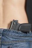Парень джинсов пояса пистолета Стоковое фото RF