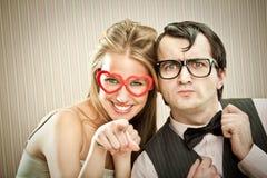 Парень человека болвана с его портретом влюбленности подруги Стоковое Изображение