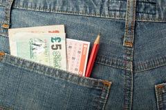 Пари денег и лотереи Великобритании смещает в карманн Стоковое Фото