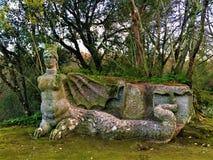 Парк чудовищ, священная роща, сад Bomarzo Гарпия с крыльями летучей мыши стоковые фотографии rf