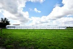 Парник с облачным небом Стоковое Изображение