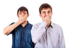 Парни закрывают рот стоковые изображения
