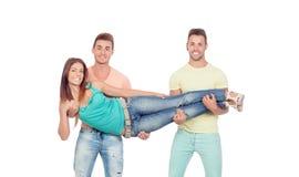 2 парня держа красивую девушку Стоковое Фото
