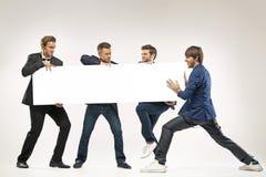 4 парня нажимая афишу Стоковые Изображения RF