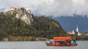 Паром на кровоточенном озере, Словении Стоковая Фотография