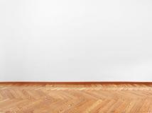 Партер и пустая белая стена стоковое фото
