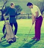 Партнеры гольфа играя совместно Стоковое Фото