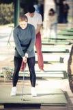Партнеры гольфа играя совместно Стоковые Изображения RF