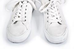 Пары белых тапок с шнурками Стоковое Изображение