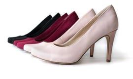 3 пары ботинок высокой пятки на белой предпосылке стоковая фотография rf