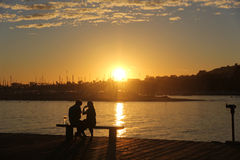 Пары в заходе солнца Стоковое Изображение