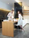 Пары в кухне l Стоковая Фотография RF
