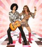 Пары диско имея потеху стоковое фото