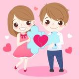 Пары держа красную головоломку влюбленности Стоковое Изображение RF