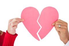 Пары держа 2 половины разбитого сердца Стоковое Фото