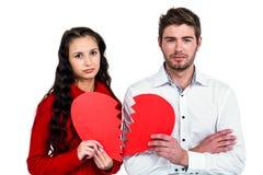 Пары держа половины сердца Стоковая Фотография RF