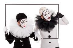 2 клоуна в рамке смотря в таком же направлении Стоковое Изображение