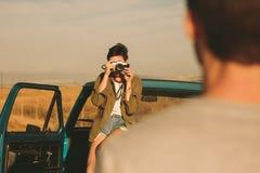Пары наслаждаясь на поездке Стоковое Фото